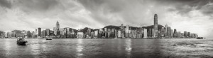 Hong Kong, China skyline panorama from across Victoria Harbor.