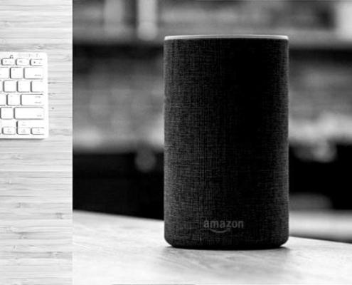 Amazon Echo sitting on a desk